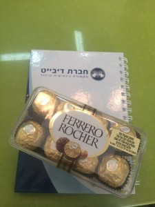 "A notebook, which says ""Debate Company"" in Hebrew, and Ferrero Rocher chocolates from my boss!"