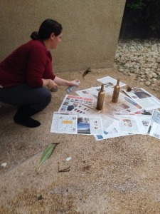 Here's a shot of me spray painting some wine bottles