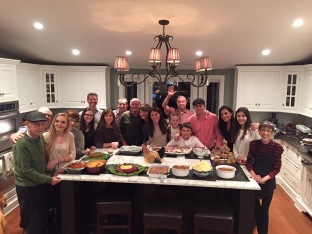 The whole family in front of our Thanksgiving spread! There were 19 of us at this year's dinner!